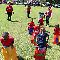 Aberdeen Elementary School students compete in a potato sack race as employees of Tupelo's Walgreens watch. The school observed Red Nose Day ahead of this week's national telethon on NBC to raise funds to end child poverty.