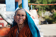 Palampur. India: Portrait of a woman in Five House village, on a walk from the Country Cotttages, in the Chandpur Tea Estate. (Photo: Ann Summa).