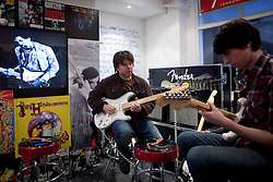 © Licensed to London News Pictures. 02/04/2013. London, UK. Experts from guitar manufacturer 'Fender'  prepare to give students a 'Jimi Hendrix Master Class' in the basement of a pop-up shop set up to celebrate a new album by the late guitar legend in London today (02/04/2013). The shop, called 'People, Hell and Angels' 'located near London's Carnaby Street, runs from the 1st of April until the 12th of April 2013 and features memorabilia, music and photographs of the guitarist and singer who died in 1970 of a drug overdose. Photo credit: Matt Cetti-Roberts/LNP