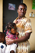 Dora Sarpong and her 14-month-old daughter Grace Ganar (8.7 kg) wait to meet a nurse at the Osu Maternity Home in Accra, Ghana on Tuesday June 16, 2009.