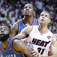 19 June 2012: Oklahoma City Thunder small forward Kevin Durant (35) and Oklahoma City Thunder guard James Harden (13) vie for the rebound with Miami Heat small forward Shane Battier (31) during the Miami Heat 104-98 victory over the Oklahoma City Thunder, in Game 4 of the 2012 NBA Finals, at the AmericanAirlinesArena, Miami, Florida, USA.