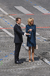French President Emmanuel Macron and wife Brigitte Macron attend Bastille Day Military Parade, Place de la Concorde, in Paris on July 14, 2017. Photo by Ammar Abd Rabbo/ABACAPRESS.COM
