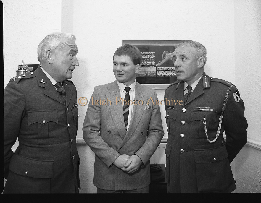 Ciaran Fitzgerald Honoured..1986..05.09.1986..09.05.1986..5th September 1986..To mark his retirement from the Defence Forces, Ciaran Fitzgerald was presented with a Hi-fi system by his colleagues. Ciaran is a noted rugby player and has captained Ireland in many international matches...Image taken of Ciaran Fitzgerald and Brig General Vincent Savino being regaled by Col. Tom Ryan,ADC to President Hillery on the occasion of Ciarans' retirement from the defense forces.