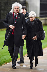 © Licensed to London News Pictures. 31/03/2018. Cambridge, UK. Former Queen guitarist BRIAN MAY and his wife ANITA DOBSON, arrive for The funeral of Stephen Hawking at Church of St Mary the Great in Cambridge, Cambridgeshire. Professor Hawking, who was famous for ground-breaking work on singularities and black hole mechanics, suffered from motor neurone disease from the age of 21. He died at his Cambridge home in the morning of 14 March 2018, at the age of 76. Photo credit: Ben Cawthra/LNP