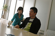 An employee brings a drink to Takafumi Horie, (now ex-)President and CEO of Livedoor Co.,Ltd. (Horie is currently under investigation for financial matters) in Tokyo, Japan, on Wednesday Apr. 6th 2005. During interviews it is common for female assistants to enter the rooms silently , bringing refreshment drinks of green tea, coffee, or orange juice, to the company head and his guests.