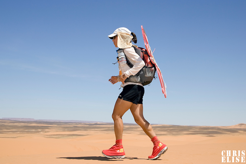 30 March 2007: #509 Lia Farley of USA runs in erg Znaigui en route to check point 3 during fifth stage of the 22nd Marathon des Sables between west of Kfiroun and erg Chebbi (26.22 miles). Lia is a member of team Good for Kids, and runs to raise funds for this organization. The Marathon des Sables is a 6 days and 151 miles endurance race with food self sufficiency across the Sahara Desert in Morocco. Each participant must carry his, or her, own backpack containing food, sleeping gear and other material.