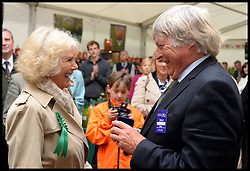 The Duchess of Cornwall hands over Lifetime achievement award to Julian Temperley the cider in the cider tent during a tour of the Royal Bath & West Show, Royal Bath & West Showground, Shepton Mallet, Somerset, United Kingdom, Wednesday, 28th May 2014. Picture by Andrew Parsons / i-Images