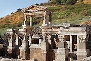 Nymphaeum Traiani or Fountain of Trajan, 102-114 AD, Ephesus, Izmir, Turkey. The fountain building was donated by Tiberius Claudius Aristion and his wife in honour of Artemis of Ephesus and Emperor Trajan. A 2 storey facade surrounded the fountain on 3 sides, while the statue of Trajan, with a globe under his feet, stood over the water outlet in the central niche overlooking the pool. The pool of the fountain was 20x10m, surrounded by columns and statues of Dionysus, Satyr, Aphrodite and the family of Trajan. Ephesus was an ancient Greek city founded in the 10th century BC, and later a major Roman city, on the Ionian coast near present day Selcuk. Picture by Manuel Cohen