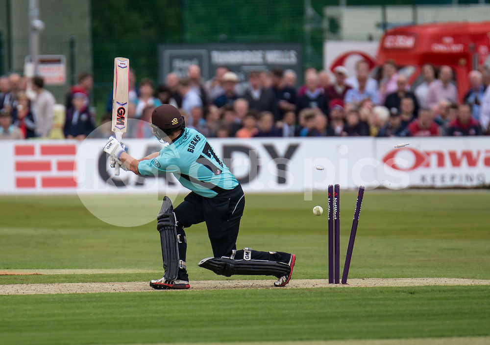 Rory Burns of Surrey is bowled by Kagiso Rabada of Kent Spitfires during the NATWEST T20 BLAST match between Kent Spitfires and Surrey at The Nevill Ground, Tunbridge Wells, England on the 15th July 2016. Photo by Liam McAvoy.