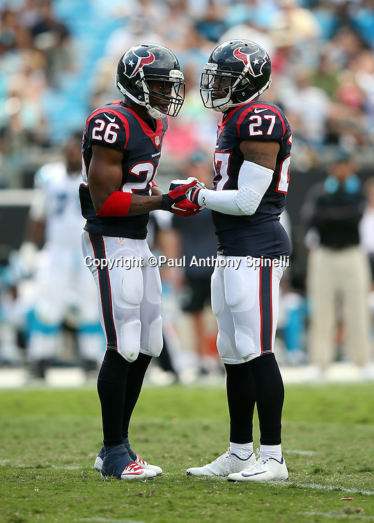 Houston Texans free safety Rahim Moore (26) and Houston Texans strong safety Quintin Demps (27) join hands before a play during the 2015 NFL week 2 regular season football game against the Carolina Panthers on Sunday, Sept. 20, 2015 in Charlotte, N.C. The Panthers won the game 24-17. (©Paul Anthony Spinelli)