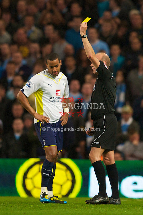MANCHESTER, ENGLAND - Wednesday, May 5, 2010: Tottenham Hotspur's Tom Huddlestone is shown the yellow card by referee Steve Bennett during the Premiership match against Manchester City at City of Manchester Stadium. (Photo by David Rawcliffe/Propaganda)