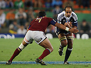 Pieter Louw tries to break through the defense of Alondo Soakai during the Super Rugby (Super 15) fixture between the DHL Stormers and the Highlanders held at DHL Newlands Stadium in Cape Town, South Africa on 11 March 2011. Photo by Jacques Rossouw/SPORTZPICS