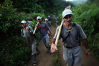 Workers hired by the Colombian government to manually eradicate coca crops hike out to the coca fields to begin work, just outside of El Campanario, in a remote area of the southern Colombian state of Nariño, on Friday, June 22, 2007. (Photo/Scott Dalton)