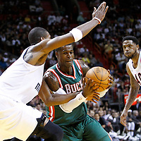 22 January 2012: Milwaukee Bucks shooting guard Stephen Jackson (5) drives past Miami Heat power forward Chris Bosh (1) during the Milwaukee Bucks 91-82 victory over the Miami Heat at the AmericanAirlines Arena, Miami, Florida, USA.