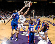 Jan 30, 2008; Manhattan, KS, USA; Kansas State Wildcats forward Michael Beasley (30) drives to the basket against pressure from Kansas Jayhawks center Cole Aldrich (45) in the first half at Bramlage Coliseum in Manhattan, KS. Kansas State defeated Kansas 84-75. Mandatory Credit: Peter G. Aiken-US PRESSWIRE