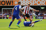 Brentford midfielder Lewis Macleod (4)  getting tackled during the EFL Sky Bet Championship match between Brentford and Ipswich Town at Griffin Park, London, England on 13 August 2016. Photo by Matthew Redman.