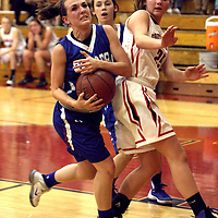 Panama's Taylor Bowen drives toward the hoop against Southwestern's Kate Johnson during second quarter action 12-10-15 photo by Mark L. Anderson