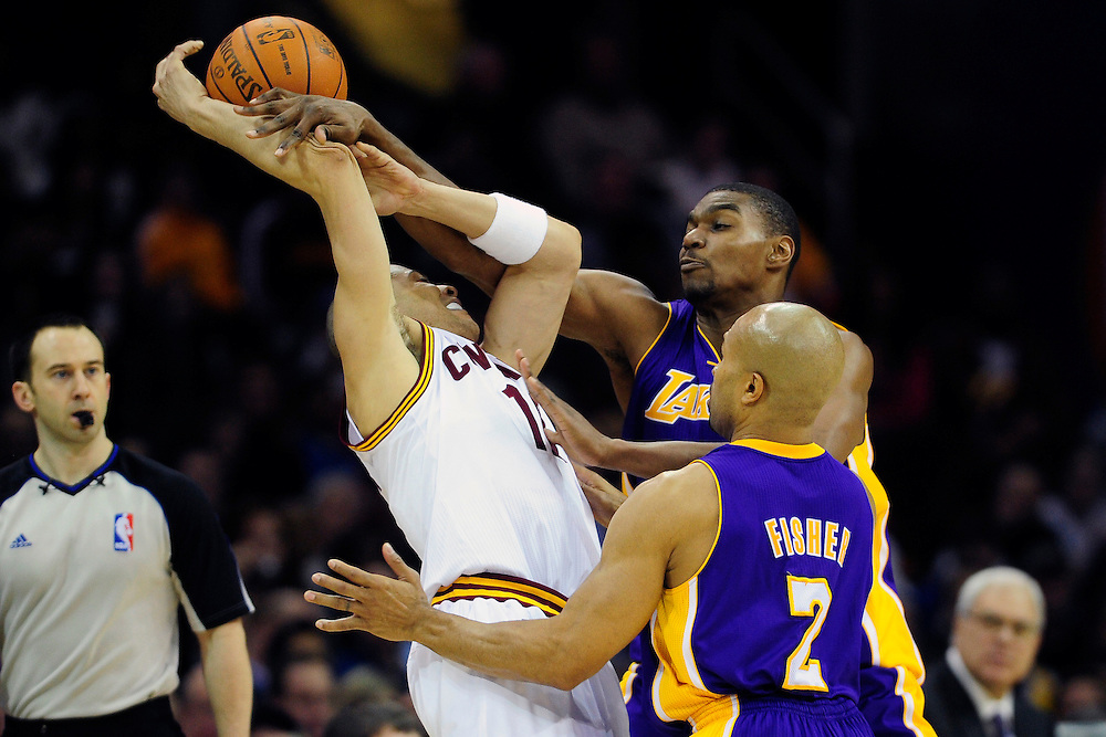 Feb. 16, 2011; Cleveland, OH, USA; Cleveland Cavaliers shooting guard Anthony Parker (18) tries to make a pass under pressure from Los Angeles Lakers center Andrew Bynum (17) and point guard Derek Fisher (2) during the fourth quarter at Quicken Loans Arena. The Cavaliers beat the Lakers 104-99. Mandatory Credit: Jason Miller-US PRESSWIRE