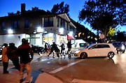 On the night before the last Presidential debate between Donald Trump and Hillary Clinton in St Louis, across town, a gunfight breaks out amongst gangs in the street.<br /> <br /> At a vigil to commemorate the death of 18 year old VonDerrit Myers Jr. at the hands of a white armed security guard, a dispute breaks out between two groups at the street intersection.<br /> At least four shooters are involved in a violent 2 minute shoot out which saw at least 58 bullets fired. Participants dive for cover and flee.<br /> Once it is over, one man lies injured, others are sped away in vehicles or run off. Blood and shell casings litter the street, and as the police secure the crime scene, the pastor calls the people to gather around and continue the vigil to honor the dead teenager. Another day of urban violence in the USA.