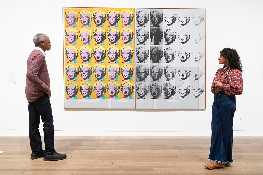 © Licensed to London News Pictures. 10/03/2020. Gallery staff view artwork titled Maryilyn Diptych, 1962, by artist Andy Warhol at an exhibition showing at the Tate Modern. London, UK. Photo credit: Ray Tang/LNP