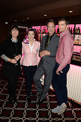 Left to right, ALISON ?, CLEO ROCOS, JULIAN CLARY and IAN MACKLEY at a party to celebrate the publication of 'Passion for Life' by Joan Collins held at No41 The Westbury Hotel, Mayfair, London on21st October 2013.