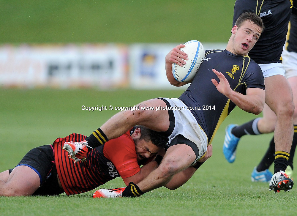Wellington's Wes Goosen is tackled by Canterbury's Blair Prinsep in the Graham Mourie Final of the Jock Hobbs Memorial National Under 19 tournament, Canterbury vs Wellington, Owen Delaney Park, Taupo, October 04, 2014. Photo: Kerry Marshall / photosport.co.nz
