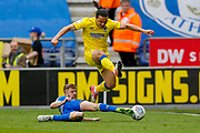 AFC Wimbledon midfielder Egli Kaja (21) is tackled during the EFL Sky Bet League 1 match between Wigan Athletic and AFC Wimbledon at the DW Stadium, Wigan, England on 28 April 2018. Picture by Simon Davies.