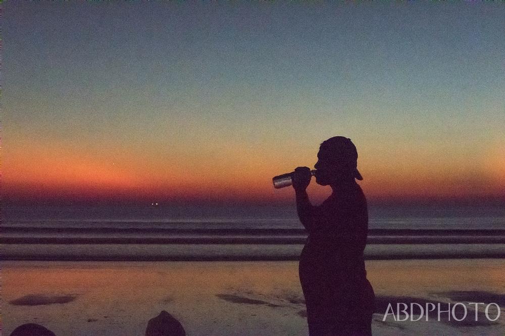 surfers kuta beach bali indonesia at sunset