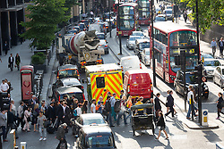 © Licensed to London News Pictures. 08/07/2015. London, UK. An emergency ambulance stuck in grid lock traffic jam on London Wall in the City of London this evening. London transport workers begin strike action tonight, which will continue tomorrow. Photo credit : Vickie Flores/LNP