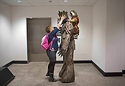UNITED KINGDOM, London: 14 March 2015. <br /> Comic Con Feature.<br /> A loving wife makes some final adjustments to her husbands cosplay uniform before entering the exhibition..<br /> Photo: Rick Findler / Story Picture Agency