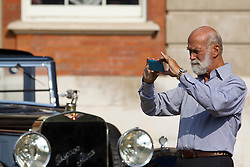 © Licensed to London News Pictures. 05/09/2013. London, UK. Prince Michael of Kent is seen using an Apple iPhone to take pictures of classic cars at the St James's Concours of Elegance classic car event at Royal Gardens of St James's Palace in London today (05/09/2013). The event, which alternates each year between Windsor Castle and St James's Palace, features sixty rare cars from across the world and takes place over the next three days. Photo credit: Matt Cetti-Roberts/LNP