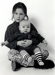 Studio portrait of girl & baby UK 1990s