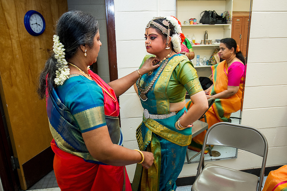 Lincroft, New Jersey, 9/20/14: Hema Ramaswamy, a young Indian American woman with Down syndrome, receives advice from her teacher Chitra Venkateswaran as she prepares backstage for her arangetram, the public performance of bharata natyam, a traditional South Indian dance form. She studied with Chitra in preparation for this recital for four and a half years.