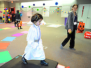 """Sawyer Vyas, 4 of Feasterville, Pennsylvania walks through """"Candyland"""" with Nicole Koch during the Fifth Annual """"Safe Trick or Treat"""" at General Electric Saturday October 24, 2015 in Bensalem, Pennsylvania. (Photo by William Thomas Cain)"""