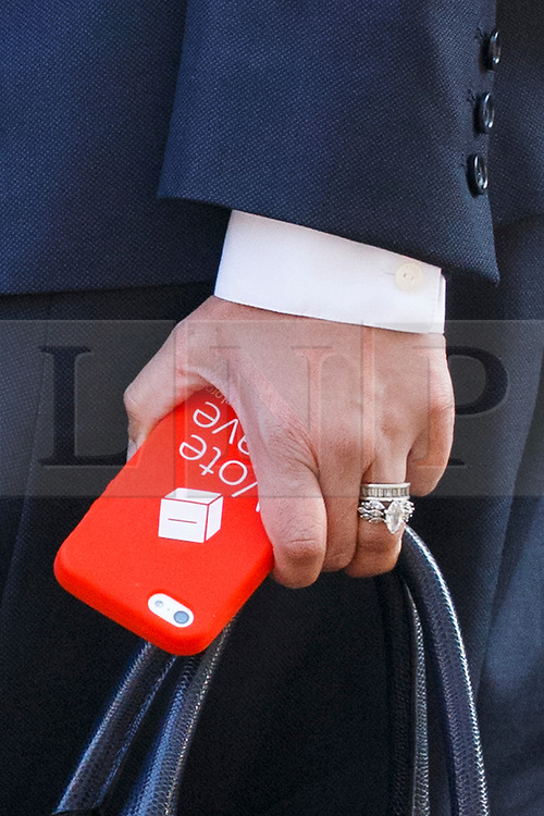 © Licensed to London News Pictures. 17/05/2016. London, UK. Minister of State for Employment PRITI PATEL's 'Vote Leave' phone case is seen whilst attending a cabinet meeting in Downing Street on Tuesday, 17 May 2016. Photo credit: Tolga Akmen/LNP