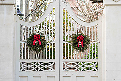 December 21, 2017 - Charleston, South Carolina, United States of America - The wooden garden gate of a historic home decorated with a Christmas wreath on Lagare Street in Charleston, SC. (Credit Image: © Richard Ellis via ZUMA Wire)