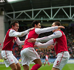 03.12.2011, DW Stadium, Wigan, ENG, Premier League, Wigan Athletic vs FC Arsenal, 14. Spieltag, im Bild Arsenal's Mikel Arteta celebrates scoring the first goal against Wigan Athletic with team-mate captain Robin van Persie and Thomas Vermaelen // during the football match of english Premier League, 14th round between Wigan Athletic an FC Arsenal at DW Stadium, Wigan, ENG on 2011/12/03. EXPA Pictures © 2011, PhotoCredit: EXPA/ Sportida/ David Rawcliff..***** ATTENTION - OUT OF ENG, GBR, UK *****