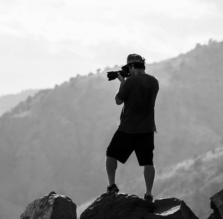 Ryan Unger of Ryan Unger Photography working hard on a peak just outside Denver, CO.