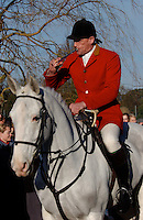 Fox Hunting.Mortimer, England, December 12th, 2004 - Alan hill, senior joint master of Vale of Aylesbury with Garth and south hunt, blowing hunting horn.