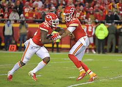 Dec 30, 2018; Kansas City, MO, USA; Kansas City Chiefs quarterback Patrick Mahomes (15) hands off to running back Damien Williams (26) during the second against the Oakland Raiders half at Arrowhead Stadium. The Chiefs won 35-3. Mandatory Credit: Denny Medley-USA TODAY Sports
