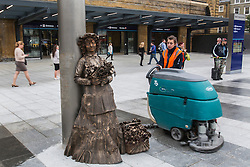 © licensed to London News Pictures. London, UK 26/09/2013. A street entertainer working at King's Cross Square as the square opens today and becomes London's newest public space. Photo credit: Tolga Akmen/LNP