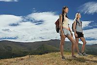 Two women hiking in hills