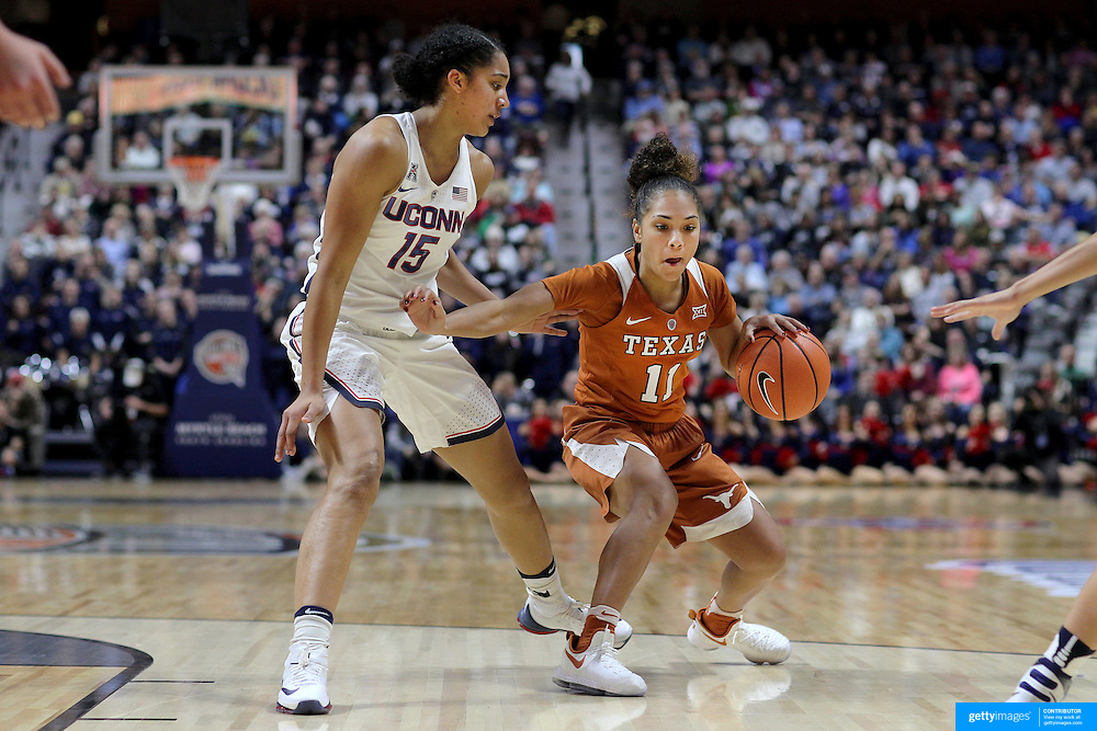 UNCASVILLE, CONNECTICUT- DECEMBER 4:  Brooke McCarty #11 of the Texas Longhorns defended by Gabby Williams #15 of the Connecticut Huskies during the UConn Huskies Vs Texas Longhorns, NCAA Women's Basketball game in the Jimmy V Classic on December 4th, 2016 at the Mohegan Sun Arena, Uncasville, Connecticut. (Photo by Tim Clayton/Corbis via Getty Images)