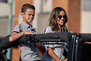 Aug 3, 2019; Canton, OH, USA; October Gonzalez, the wife of Tony Gonzalez, and son River Gonzalez during the Pro Football Hall of Fame Grand Parade on Cleveland Ave. in Downtown Canton. (Robin Alam/Image of Sport)
