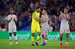 LONDON, ENGLAND - Monday, August 20, 2018: Liverpool's goalkeeper Alisson Becker and Roberto Firmino after the FA Premier League match between Crystal Palace and Liverpool FC at Selhurst Park. Liverpool won 2-0. (Pic by David Rawcliffe/Propaganda)