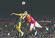 MANCHESTER, ENGLAND - FEBRUARY 03:  Tom Elliott of Cambridge United and Chris Smalling of Manchester United compete for the header during the FA Cup Fourth round replay match between Manchester United and Cambridge United at Old Trafford on February 3, 2015 in Manchester, England.  (Photo by Alex Livesey/Getty Images)