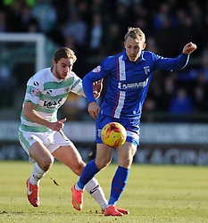 Gillingham's Danny Galbraith is tackled by Yeovil Town's Sam Foley  - Photo mandatory by-line: Harry Trump/JMP - Mobile: 07966 386802 - 21/02/15 - SPORT - Football - Sky Bet League One - Yeovil Town v Gillingham - Huish Park, Yeovil, England.