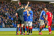 Alfredo Morelos receives a yellow card for simulation during the William Hill Scottish Cup quarter final replay match between Rangers and Aberdeen at Ibrox, Glasgow, Scotland on 12 March 2019.