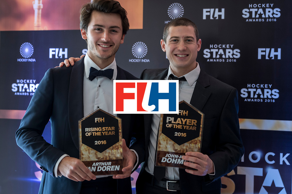 CHANDIGARH, INDIA - FEBRUARY 23: FIH Male Rising Star of the Year Arthur Van Doren [L] of Belgium and FIH Male Player of the Year John-John Dohmen [R] of Belgium pose for a picture during the FIH Hockey Stars Awards 2016 at Lalit Hotel on February 23, 2017 in Chandigarh, India. (Photo by Ali Bharmal/Getty Images for FIH)