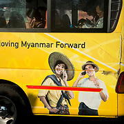 Myanmar (Burma). Yangon. Public bus painted with an advert saying 'Forward Myanmar'.